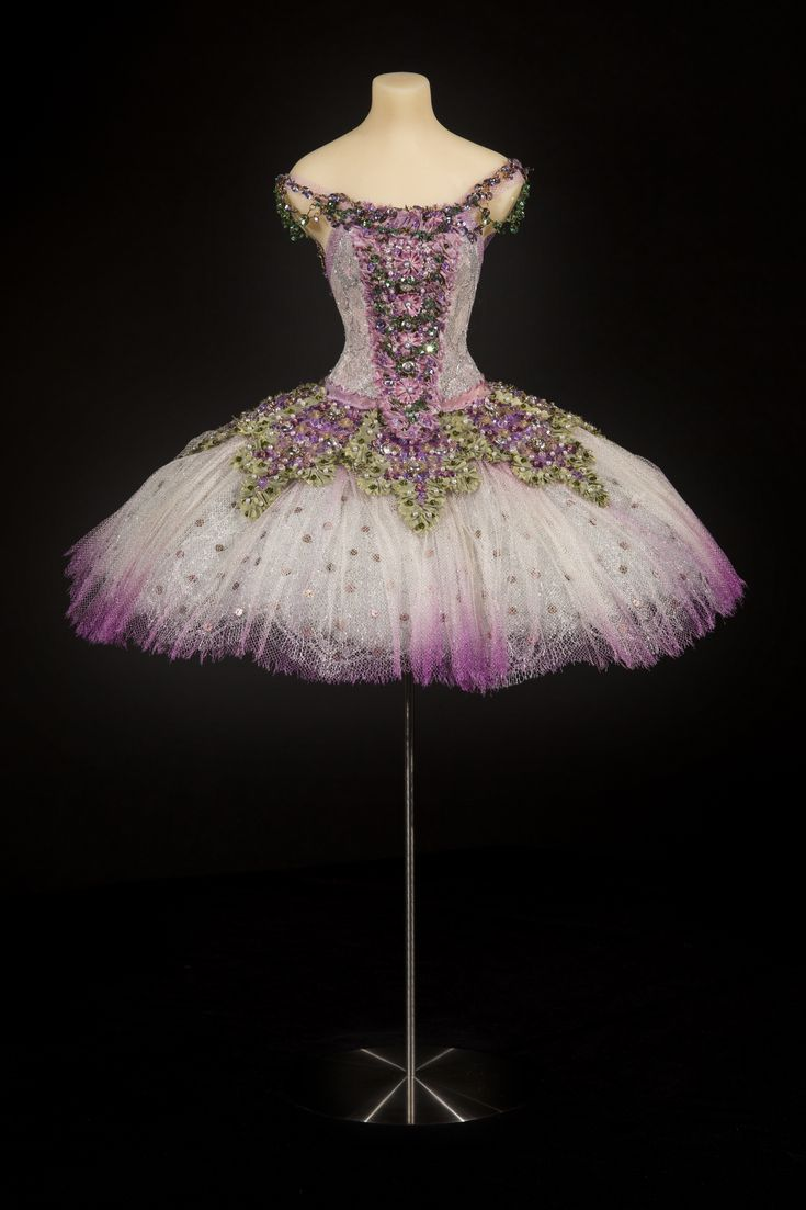 Our 'Lilac Fairy' miniature ballet costume. A highly decorative and glamorous tutu, with appliqued skirt and bodice panels edged in shot silk taffeta, encrusted with Swarovski crystals, seed pearls and very rare, delicately shaped original 1920s gelatine sequins.   Photography by George Chinn.  For more info sign up to our newsletter: www.thelittlecostumeshop.com/weddings/contact