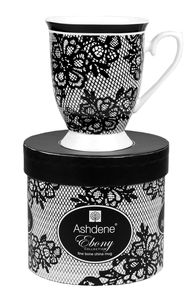Ebony Mug.  Elegance of black & white with lace pattern, the mug is in a feminine footed style with a delicate handle.