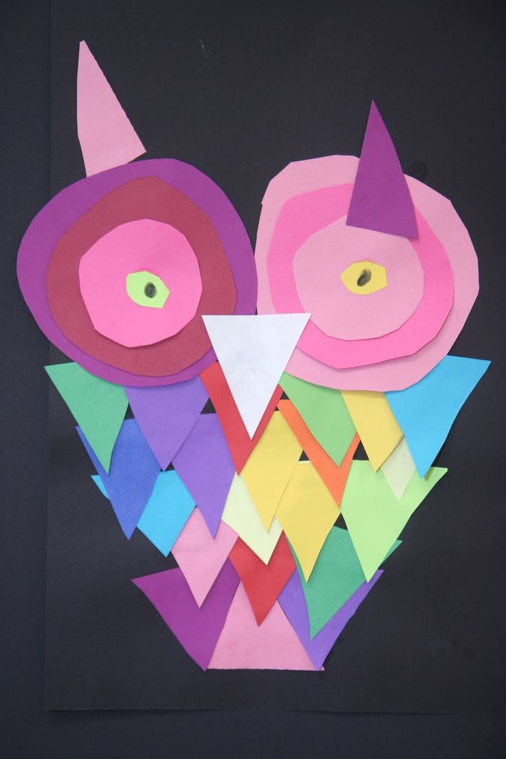 For second grade art today, we made owls using different sizes of pre-cut squares. I showed them how to cut a triangle out of a square by t...
