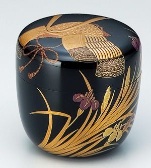 "Natsume tea container with design of samurai helmet and iris, which are a homonym for ""victory"""