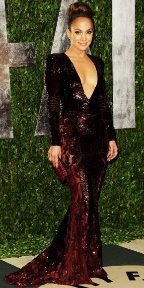 Jennifer Lopez in a beaded Zuhair Murad gown, H. Stern diamonds and a red Swarovski clutch