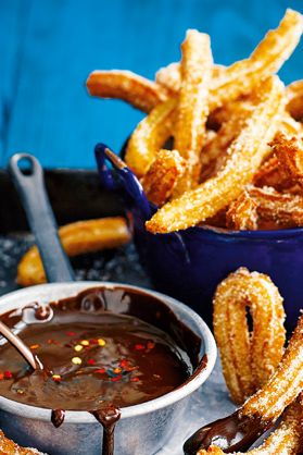 The ultimate way to round off a Mexican-themed sharing feast, these delicious churros are fried until golden and crisp, before being coated in sugar and served alongside a velvety dipping sauce of fiery chilli-chocolate. | Tesco