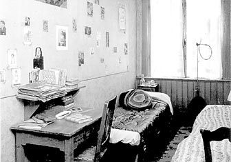 This picture shows the pictures of celebrities on the wall, which are essential to the setting of her room.