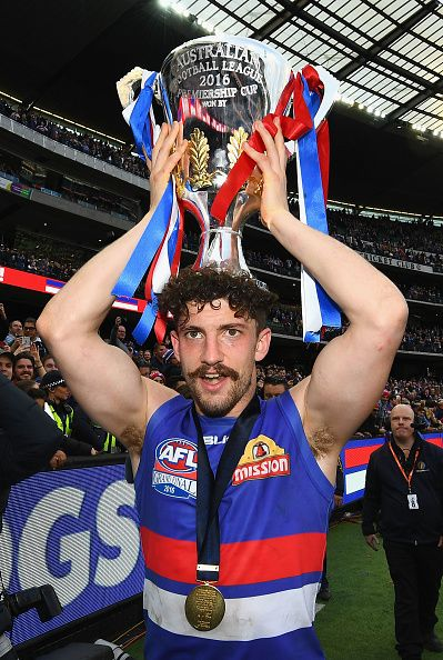 #AFLGF2016 Tom Liberatore of the Bulldogs celebrates with the trophy after winning the 2016 AFL Grand Final match between the Sydney Swans and the Western...