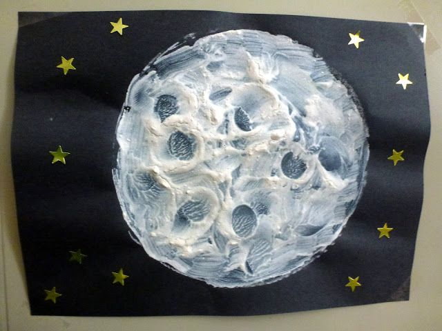 kids moon actvities. flour and white paint mixture. use a bottle cap to make the round circular craters on the moon.