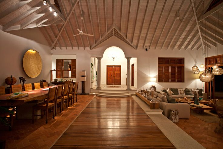A stunning villa in the caribbean by Nomade Architettura http://www.nomadearchitettura.com/#all  timber floor, local bricks, slice of tree table, moon light by catellani smith, murano chandelier, granite columns