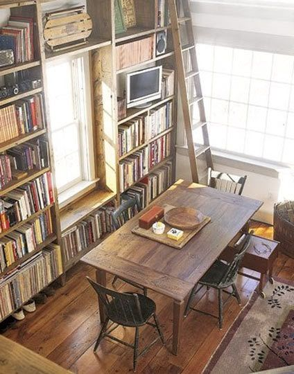 More bookcases to love! I've rounded up some images of bookcases that extend over the top of doorways and windows.