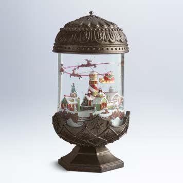 I also NEED this...Amazon.com: 2011 Hallmark SANTA TAKES FLIGHT Special Edition Snow Globe: Home & Kitchen