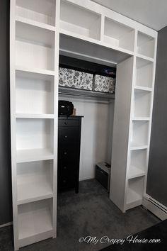 Created bookshelves around an existing closet -- good idea.