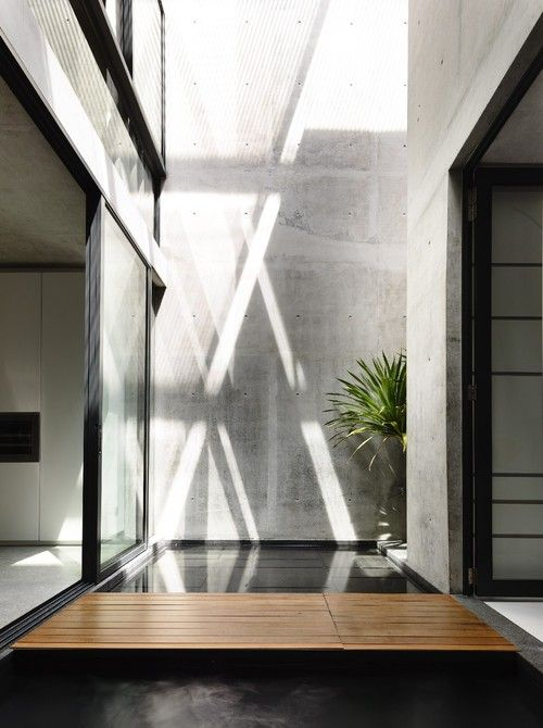 An understated courtyard that allows light to flow through the centre of this home, creating two living spaces that flow seamlessly together.