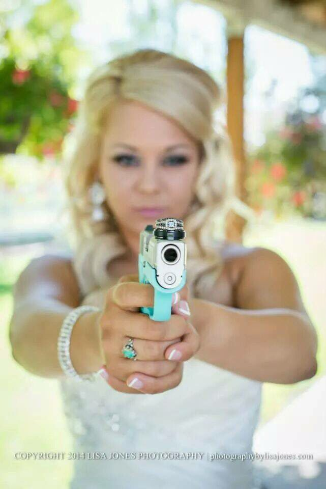 Given a Tiffany Blue Gun on her wedding day engraved with their wedding date. Swoon