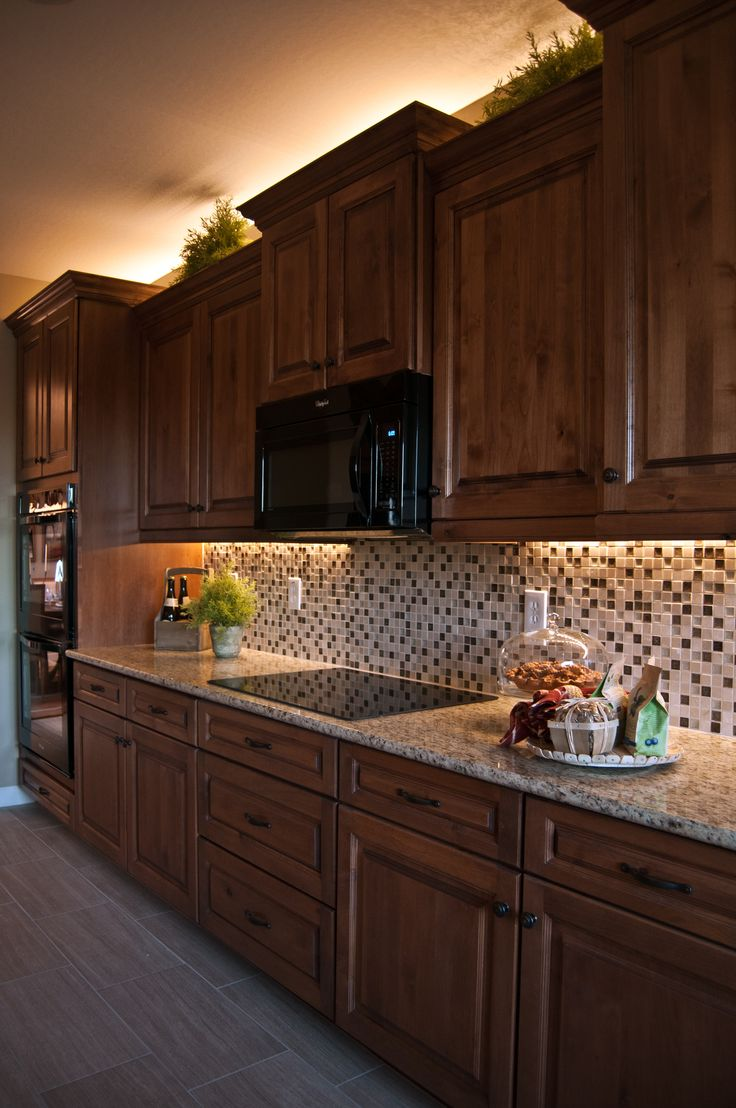 Inspired LED lighting in traditional style kitchen- warm white LEDs under cabinet & above crown molding
