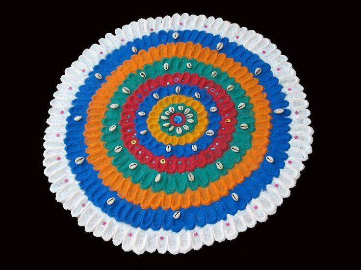 A color powder rangoli made with thumb impressions