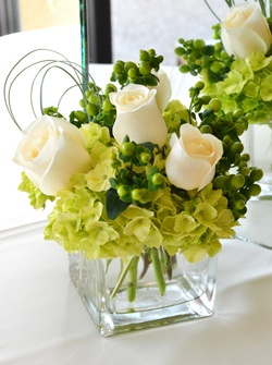 country flower arrangements - Possible center piece orange flowers instead of white roses