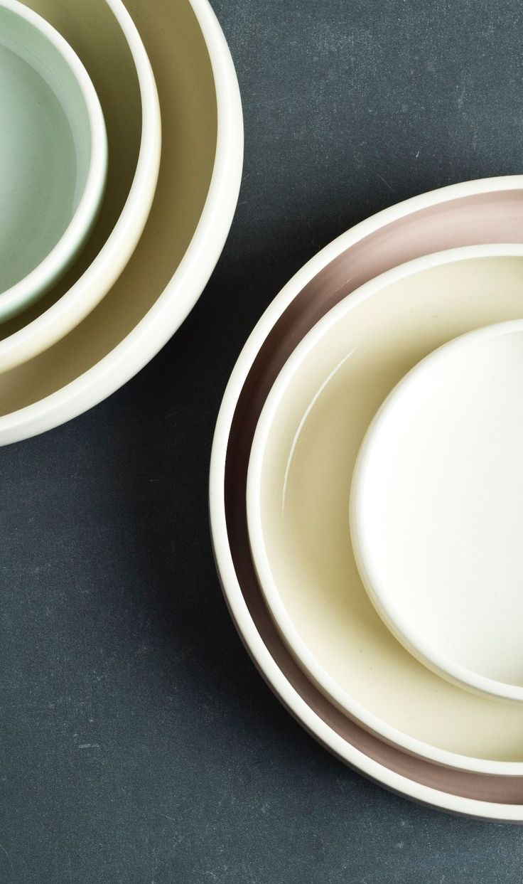 Porcelain nesting bowls in subtle hues. Hand thrown and trimmed on the potter's wheel by the artist.