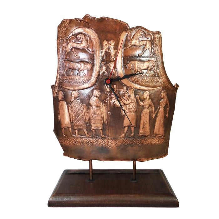 This wonderful copy of the breastplate, depicting Zeus and Apollo with his lyre was turned into a marvellous clock.The original copper breastplate is kept at the museum of Ancient Olympia. It is likely the work of an island bronzesmith, dated between 650-625 BC. The copy is made out of copper and is placed on a wooden base. This exceptional historical item is made for all the admirers of the ancient greek culture.