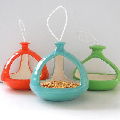 Love these colorful and cheery ceramic bird feeders!