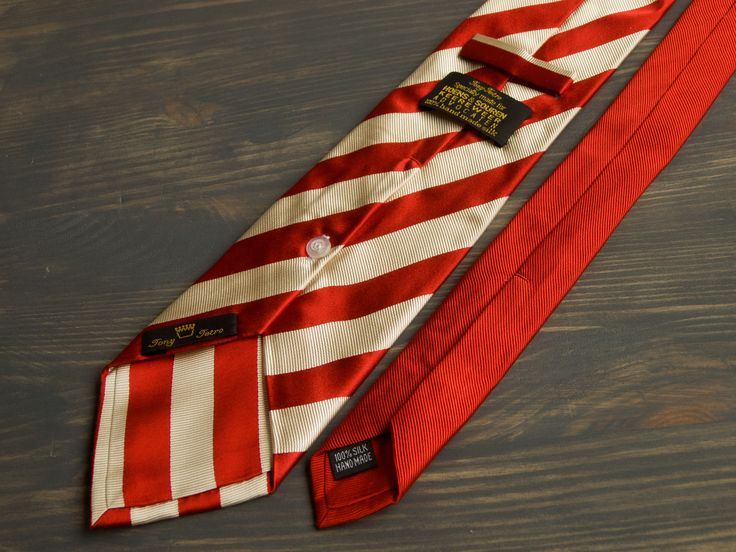 Designers Tony Tetro all silk mens necktie from limited edition for Hoens&Souren Keereweer Advocaten Extra-long self-tipped necktie. Shiny striped satin silk in bright red and milky while. Lovely (and functional) button at the back side. Brand: Tony Tetro Material: 100% silk Color: bright red and white  Dimensions (cm | inches): Width: 9 cm | 3 1/2 Length: 162 cm | 63 3/4  Condition: pre-owned item with no defects    *** You are welcome to visit my necktie shop! If You want to b...