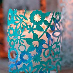 Use scrapbook paper and a little paint to make gorgeous, simple cut-out paper candle holders.