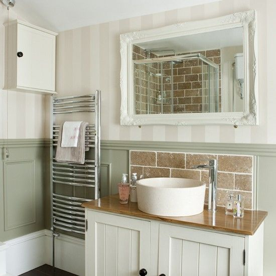 downstairs bathroom - leave space on sides of vanity, green walls with white vanity, paneling