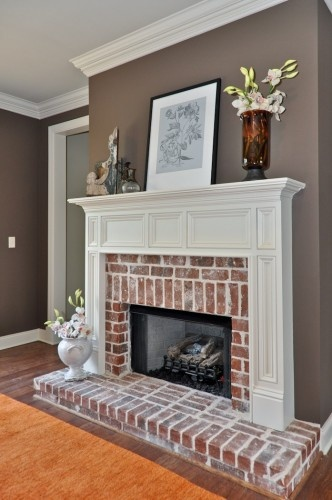 Signature Homes Fireplace at James Hill living room - wall color. Love the exposed brick and mantle