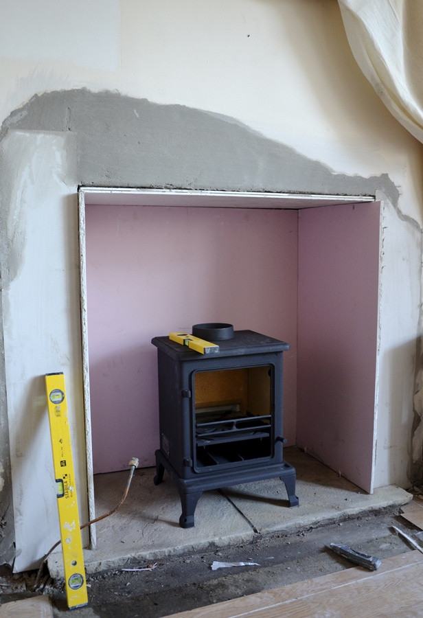 build a hearth for the wood-burning stove (stone and mantel)