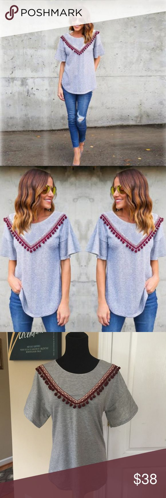 amazing t-shirt w/pom-pom fringe detail Such a great top I'm keeping one for myself! Stretchy 65/35 cotton poly grey T-shirt material with burgundy pom pom on Aztec style ribbon in a v pattern on from only. Sleeves have wide butterfly style and fits true to size M-36 L-38 before stretching Tops Tees - Short Sleeve