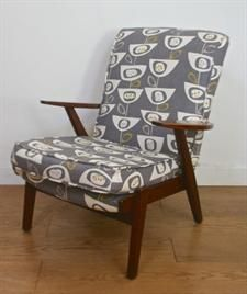 1950s Parker Knoll chair  Ref: EM0984  A stylish and comfortable vintage easy chair by Parker Knoll re-upholstered to meet fire regs and covered in a contemporary fabric 'Seedhead' by John Lewis. Sits on a teak framework and is sized 65cm wide x 80cm high x 70cm deep. Seat height is 40cm.  Elephant & Monkey - Price: £295