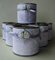 Tin cans covered with lace