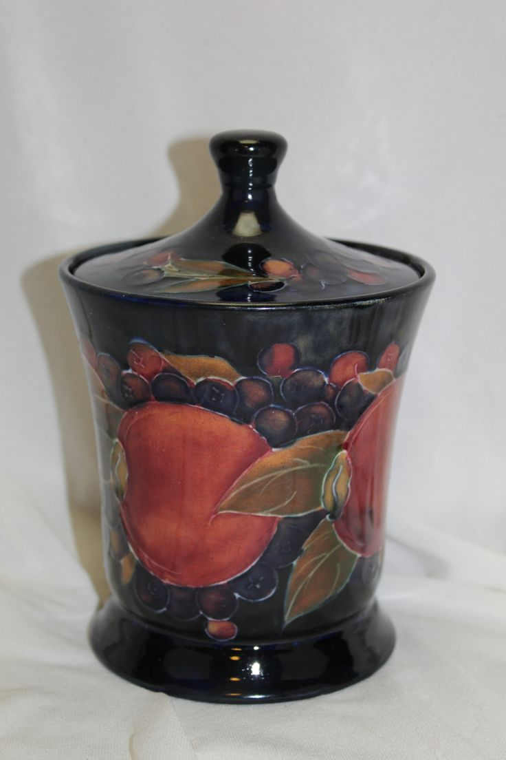 A very colourful bunch of pomegranates on a wonderfully shaped Moorcroft lidded jar that first saw the light of day around 1913. www.chinaroseantiques.com.au