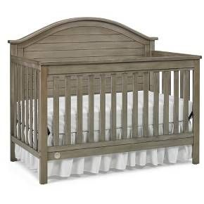 The Fisher-Price Haley 4 in 1 Convertible crib is the epitome of the Farmhouse Chic look. It features a gently arched full panel headboard and simulated stacked planks contained by generous moldings. The ample proportions and details of this on trend crib make it a great value, giving the illusion you spent hundreds more. Made of New Zealand Pine, a sustainable and renewable resource.