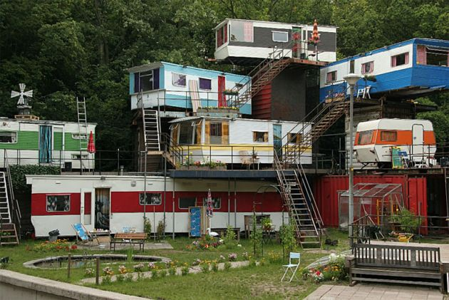 Interesting concept to use gutted trailers/campers as upper floors on container homes; they are much lighter. Could also be used as interior rooms to a container bunker.