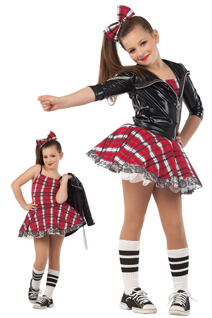 15385 A Little Attitude   Hip Hop Funk Dance Costumes   Dansco 2015   Red plaid printed and black spandex leotard with adjustable black elastic straps. Attached matching top skirt over black lace and white chiffon skirts. Separate black fantasy spandex jacket with metal ring zipper. Metal chain trim. Headpiece and socks included.