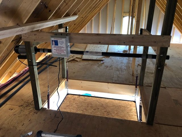 700 Lbs Attic Lift W Wireless Remote Automatically Lowers To The Floor And Stops Once The Platfo Attic Lift Diy Garage Storage Cabinets Pole Building Garage