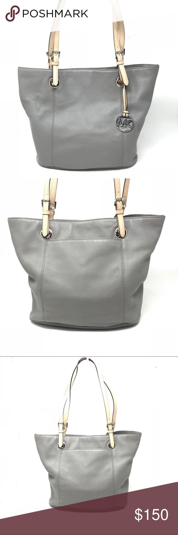 "Michael Kors like new Jet Set Gray Leather Tote •Michael Kors Jet Set Large tote, gray genuine leather with beige strap •style # 38F2CTTT7L •Condition: Like new - only used a few times •Any flaws: no - perfect condition •Size: bag: approx 17"" @ top, 12"" @ bottom, bag height: 11.5""; bag depth: approx 5.5"" •Strap drop: Approx 10"", adjustable but never adjusted from purchase •Closure: Metal, magnetic •Follow me on IG for sneak peeks before new items go live! @myjeanmarie.posh.closet •Comes from…"