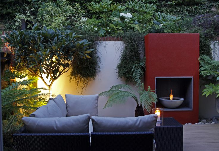 uplighting specimen trees adds a wonderful ambience to this garden