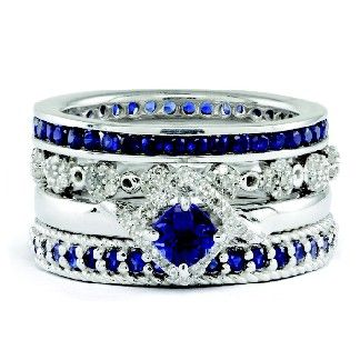 Four stackable rings in sterling silver, sapphire, and diamond.