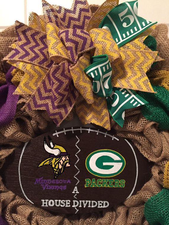 23 burlap Minnesota Vikings and Greenbay Packers house divided wreath. Made with natural color, yellow, purple, and green burlap. Decorated with a wood hand painted house divided football sign, and a bow made of chevron stripe burlap and yard line ribbon to match the team colors. Football season is almost here. This Minnesota Vikings / Greenbay Packers house divided front door wreath is the perfect football front door wreath for the household that just cant agree on teams. This house div...
