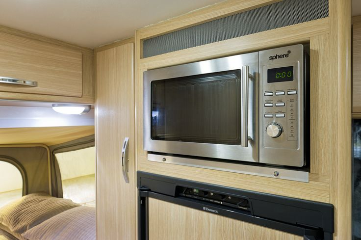 A large 150 litre Fridge and Microwave  #campingmadeeasy
