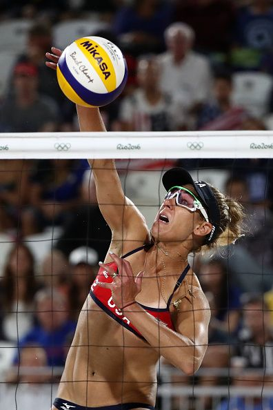 #RIO2016 April Ross of United States bumps the ball during the Women's Beach Volleyball preliminary round Pool C match against Fan Wang and Yuan Yue of China...