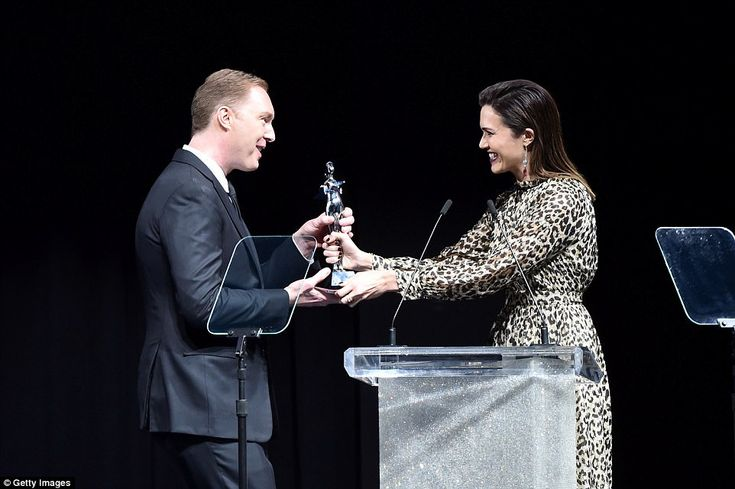 Congratulations:Stuart Vevers accepts the award for Accessory Designer of the Year from Mandy Moore