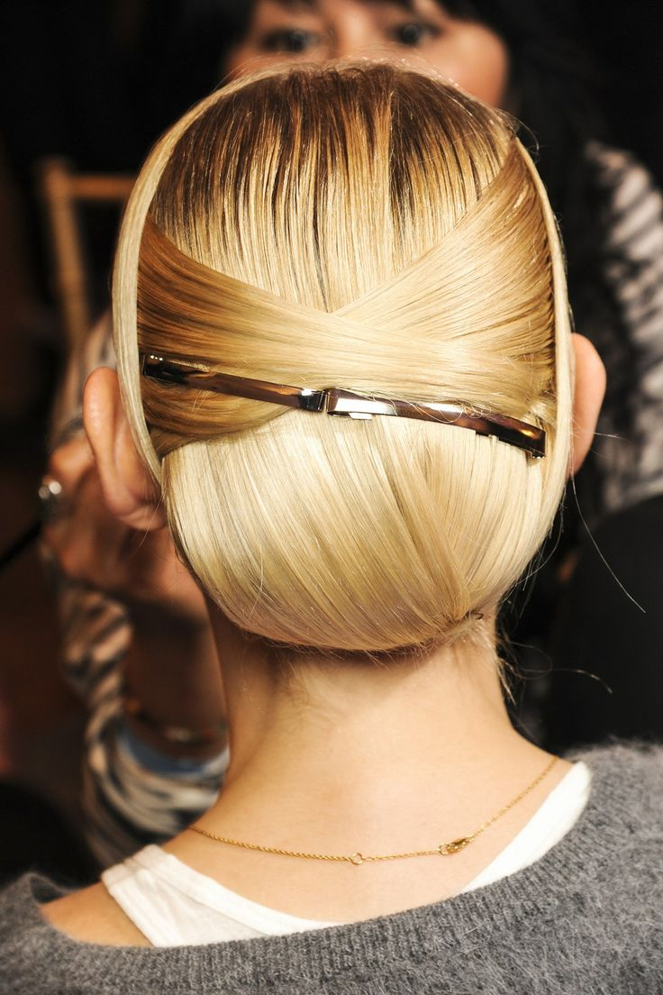 Backstage Hair: Autumn/Winter 2013-14 - Jason Wu: Complicated, neat up-dos were created from interwoven sections of hair at the back of the head.