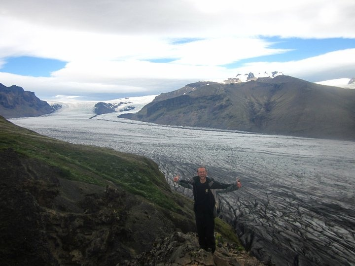 James, on the EVS workcamp leader with Seeds Iceland 2010, relaxing by Vatnajokull glacier after clearing lupin plants from the national park.