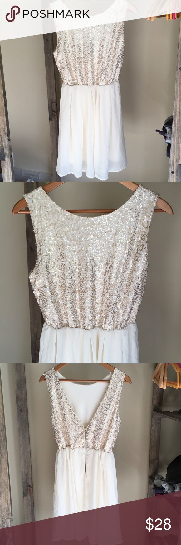 """🆕 Listing! Charming Charlie Sequin dress Adorable gold and cream Sequin dress from Charming Charlie.  Deep V-cut in the back with zipper.  Flowy bottom half.  In excellent condition.  Measures 34"""" long.  Also available in black, size Medium. Charming Charlie Dresses"""