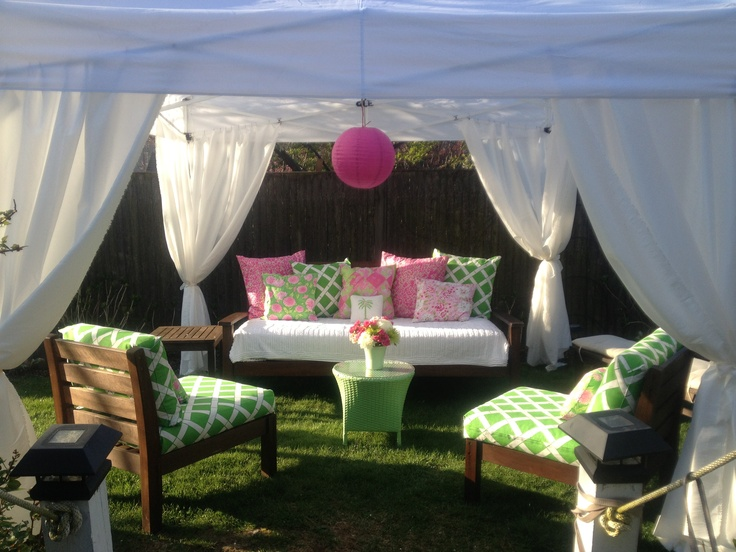 """I added fabric to curtains on a simple """"Ez Up"""" Tent. Re-covered cushions and made pink and green pillows."""