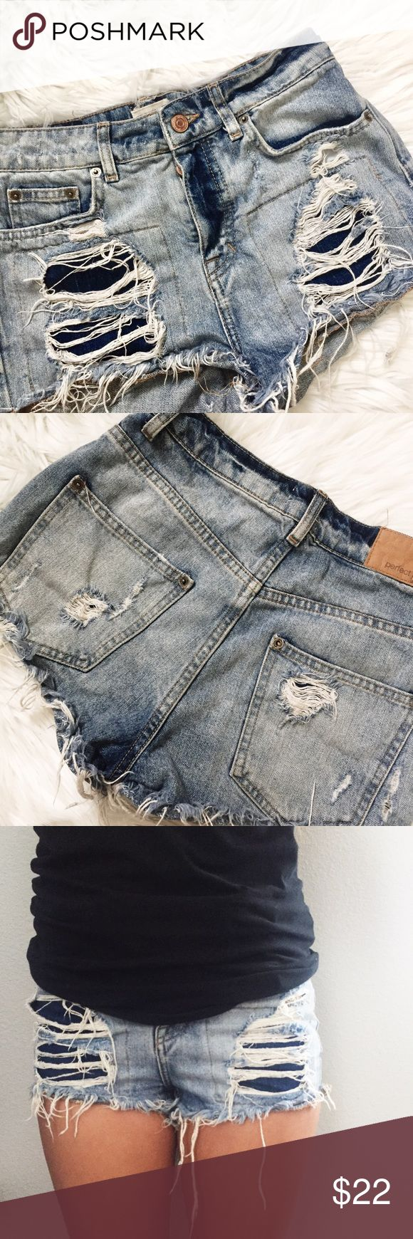 "• BOGO FREE SALE | Distressed denim shorts *BUY ONE, GET ONE FREE SALE. Until 4/2. Please read the first listing in my closet for details!* Tag reads size 34 but it's EUR; equivalent to USA size 4. Great condition. Heavy distress front, light distress back. Acid wash. Button enclosure. Made in Turkey.  · 100% cotton · Length | 10"" · Inseam 