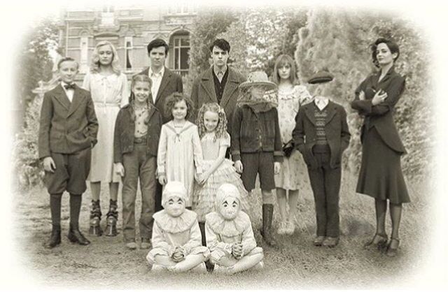 From left to right: Emma Bloom. Jacob Portman. Enoch O'Connor. Olive Abroholos Elephanta. Horace Somnusson. Fiona Frauenfeld. Bronwyn  Bruntley. Claire Densmore. Hugh Apiston. Millard Nullings. Miss Alma LeFay Peregrine. The masked twins