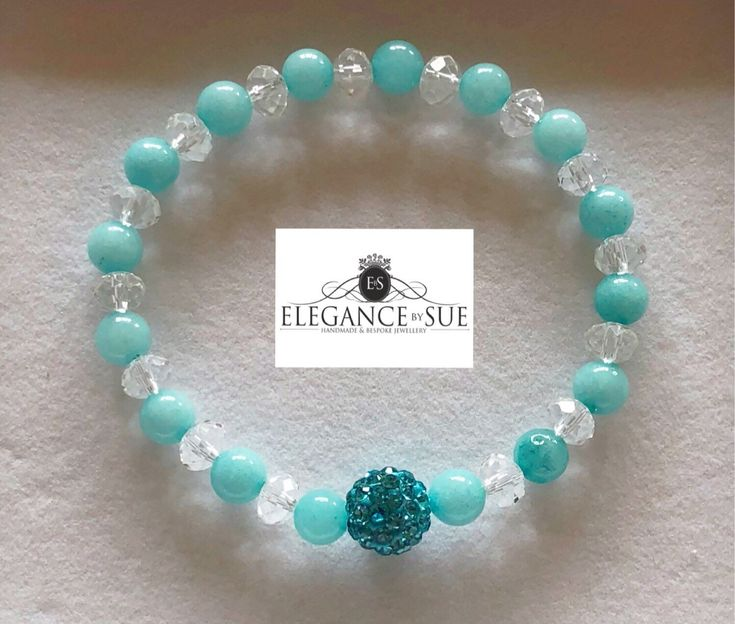 A personal favourite from my Etsy shop https://www.etsy.com/uk/listing/608087721/amazonite-and-crystal-bead-stretch
