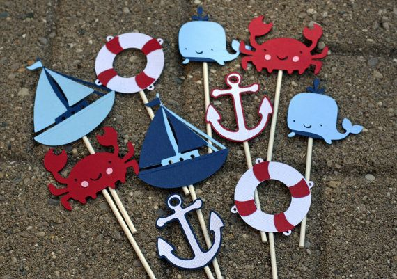 Welcome to AngiesDesignz! Prior to ordering this item, please see announcement on my shop main page to see my current availability: http://www.etsy.com/shop/AngiesDesignz _________________________________________________________________  **PLEASE INCLUDE PARTY DATE WITH ORDER** 12 Nautical themed cupcake toppers. You will receive an assortment of sailboats, anchors, life preservers, crabs & whales. All done in red, light blue, white, and navy. Items are attached to 4 lollypop sticks. Colors…