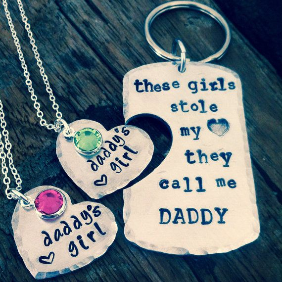 "This set is the perfect gift for any dad! Hand stamped keychain and necklace set with the words ""These girls stole my heart they call me"